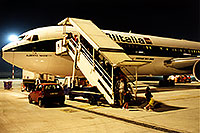 /images/133/1998-12-italy-milano-airport.jpg - #00210: red car by people getting off Alitalia airplane at Milano airport … Dec 1998 -- Milano, Italy