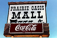 /images/133/1999-04-south-dakota-sign.jpg - #00325: Prairie Oasis Mall - Cowboy and cows wagon picture - Coca Cola sign … Christina moving Chicago-Phoenix … April 1999 -- Faith, South Dakota