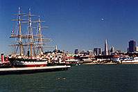 /images/133/2001-07-sfrisco-view1.jpg - #00877: Ship docked in San Francisco harbor … people swimming in the Bay … Seagull and Zeppelin in the air  … July 2001 -- San Francisco, California