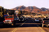 /images/133/2003-08-flagstaff-peaks1.jpg - #01296: the best view is from the middle of the road … red Jeep Wrangler leaving Flagstaff on I-17 to Phoenix  … August 2003 -- Humphreys Peak, Flagstaff, Arizona