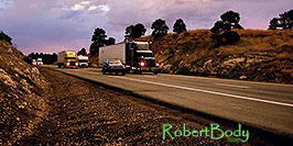 /images/133/2003-08-flagstaff-trucks-sunset-pano.jpg - #01281: outside of Flagstaff, heading to Santa Fe … August 2003 -- Flagstaff, Arizona