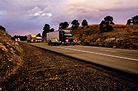 /images/133/2003-08-flagstaff-trucks-sunset.jpg - #01300: outside of Flagstaff, heading to Santa Fe … August 2003 -- Flagstaff, Arizona