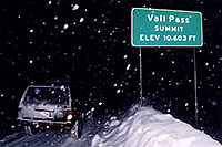 /images/133/2003-12-vail-pass-sign-jeep.jpg - #01429: Vail Pass Summit, Elevation 10,603ft … A snowy night at Vail Pass … Dec 2003 -- Vail, Colorado