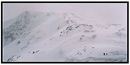 /images/133/2004-04-loveland-lost-pano.jpg - #01463: backcountry skiers heading uphill … frequent strong winds don