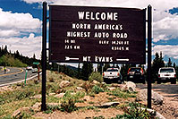 /images/133/2004-06-mtevans-highest-road.jpg - #01557: `Welcome - North Americas Highest Auto Road - elev 14,260 ft (4,346.5 meters) - 14 miles (22.5km)`(br)start of Mt Evans road, highest road in North America … June 2004 -- Mount Evans Road, Mt Evans, Colorado