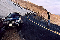 /images/133/2004-06-mtevans-holly06.jpg - #01565: Holly hiking along Mt Evans road … my Jeep next to 8ft tall snowbank … June 2004 -- Mount Evans Road, Mt Evans, Colorado