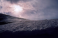 /images/133/2004-06-mtevans-snowfield-sun.jpg - #01588: 8ft tall  Mt Evans snowbanks … June 2004 -- Mount Evans Road, Mt Evans, Colorado