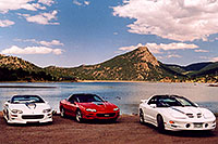 /images/133/2004-07-estes-transams1.jpg - #01663: white and red Pontiac TransAm cars at Estes Lake … July 2004 -- Estes Park, Colorado