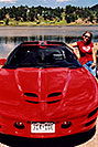 /images/133/2004-07-estes-transams5.jpg - #01680: Aneta with a red Pontiac TransAm at Estes Lake … July 2004 -- Estes Park, Colorado