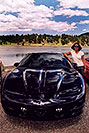 /images/133/2004-07-estes-transams6.jpg - #01681: Ola with a black Pontiac TransAm at Estes Lake … July 2004 -- Estes Park, Colorado