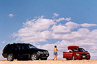 /images/133/2004-07-powell-ewka-car.jpg - #01789: Ewka walking to Aneta and her red Subaru at Lone Rock … July 2004 -- Lone Rock, Lake Powell, Utah