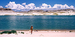 /images/133/2004-07-powell-ewka-walk-pano.jpg - #01791: Ewelina coming from suntanning to the cars … July 2004 -- Lone Rock, Lake Powell, Utah