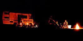 /images/133/2004-07-powell2-night1-pano.jpg - #01757: campfire at Lone Rock  … July 2004 -- Lone Rock, Lake Powell, Utah