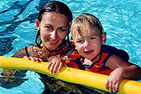 /images/133/2004-08-pool-ola-float.jpg - #01974: Ola and Cooper in the pool … August 2004 -- Greenwood Village, Colorado