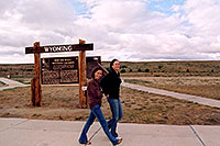 /images/133/2004-08-wyo-casper-girls.jpg - #02012: Ola and Ewka walking in Wyoming wind … skies clearing up as we near Yellowstone … August 2004 -- Casper, Wyoming