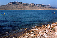 /images/133/2004-08-wyo-cody-lake4.jpg - #02008: morning kayakers at Buffalo Bill Reservoir … August 2004 -- Buffalo Bill Reservoir, Cody, Wyoming