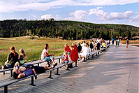/images/133/2004-08-yello-faith-dadson1.jpg - #02077: Old Faithful geyser on the left … people awaiting another scheduled eruption … August 2004 -- Old Faithful Geyser, Yellowstone, Wyoming