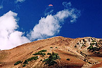 /images/133/2004-10-cinnamon-para-oran1.jpg - #02253: Orange Paraglider over Cinnamon Mountain (12,293ft) … Oct 2004 -- Paradise Divide, Crested Butte, Colorado
