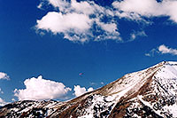 /images/133/2004-10-cinnamon-para-red1.jpg - #02294: Red Paraglider west of Cinnamon Mountain (12,293ft)… Oct 2004 -- Paradise Divide, Crested Butte, Colorado