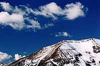 /images/133/2004-10-cinnamon-para-red2.jpg - #02272: Red Paraglider west of Cinnamon Mountain (12,293ft)… Oct 2004 -- Paradise Divide, Crested Butte, Colorado