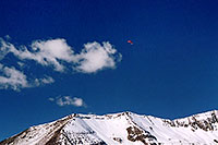 /images/133/2004-10-cinnamon-para-red3.jpg - #02296: Red Paraglider west of Cinnamon Mountain (12,293ft)… Oct 2004 -- Paradise Divide, Crested Butte, Colorado