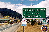 /images/133/2004-10-crested-sign2.jpg - #02319: red Jeep Wrangler heading to Gunnison from Crested Butte … Oct 2004 -- Crested Butte, Colorado