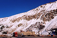 /images/133/2004-10-summit-pass-truck1.jpg - #02384: red semi truck leaving Eisenhower Tunnel (elev 11,013ft) and heading to Silverthorne  … Oct 2004 -- Eisenhower Tunnel, Colorado