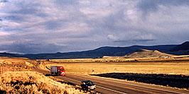 /images/133/2004-10-yaks-landscape-pano.jpg - #02392: red semi truck heading to Gunnison in the late October afternoon … Yaks to the right  … October 2004 -- Sargeants, Colorado