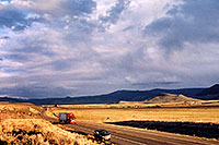 /images/133/2004-10-yaks-landscape.jpg - #02392: red semi truck heading to Gunnison in the late October afternoon … Yaks to the right  … October 2004 -- Sargeants, Colorado
