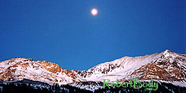 /images/133/2005-01-fremont-pass-sunset-pano.jpg - #02443: Moon over Fremont Pass, looking from Leadville side  … Dec 2004 -- Fremont Pass, Colorado
