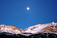 /images/133/2005-01-fremont-pass-sunset.jpg - #02408: Moon over Fremont Pass, looking from Leadville side  … Dec 2004 -- Fremont Pass, Colorado