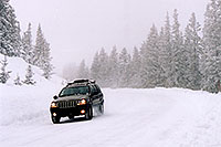 /images/133/2005-02-evans-jeep-moving.jpg - #02459: jeep on road before Mt Evans … Feb 2005 -- Mt Evans, Colorado