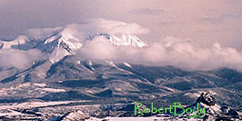 /images/133/2005-03-delnorte-mtns2-pano.jpg - #02480: Fog over peaks along Spanish Trail  … March 2005 -- Del Norte, Colorado
