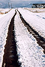 /images/133/2005-03-delnorte-snow-road.jpg - #02484: road heading towards the mountains … along Spanish Trail … March 2005 -- Del Norte, Colorado