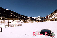 /images/133/2005-03-silverton-stuck-car.jpg - #02582: parked last Fall in Silverton … March 2005 -- Silverton, Colorado