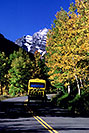 /images/133/2005-09-maroon-road2-v.jpg - #02630: yellow Blazing Adventures tour bus on a road to Maroon Bells … images of Maroon Bells … Sept 2005 -- Maroon Bells, Colorado
