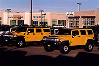 /images/133/2006-02-hummers-medved-02.jpg - #02791: yellow H3 (front)  and yellow H2 Hummers in Castle Rock … Feb 2006 -- Castle Rock, Colorado