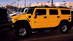 /images/133/2006-02-hummers-medved-03.jpg - #02792: yellow and white H2 Hummers in Castle Rock … Feb 2006 -- Castle Rock, Colorado