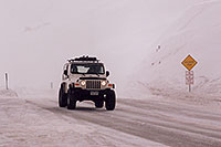 /images/133/2006-02-loveland-jeep2.jpg - #02755: white Jeep Wranger in snowstorm at top of Loveland Pass … Feb 2006 -- Loveland Pass, Colorado