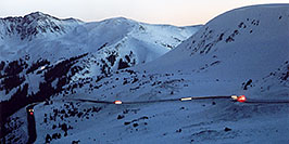 /images/133/2006-02-loveland-night-first-w.jpg - #02757: cars moving along the road up to Loveland Pass from Keystone side … Feb 2006 -- Loveland Pass, Colorado