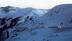 /images/133/2006-02-loveland-night1.jpg - #02801: cars moving along the road up to Loveland Pass from Keystone side … Feb 2006 -- Loveland Pass, Colorado