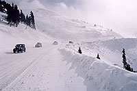 /images/133/2006-02-loveland-rd-jeep2.jpg - #02778: blue Jeep Wrangler driving down from Loveland Pass … Feb 2006 -- Loveland Pass, Colorado