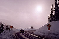 /images/133/2006-02-loveland-road-sun.jpg - #02782: car driving up to Loveland Pass from Keystone side … Feb 2006 -- Loveland Pass, Colorado