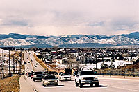 /images/133/2006-03-highlands-cars-mtns.jpg - #02842: Cars in Highlands Ranch with western mountains in the background … March 2006 -- Highlands Ranch, Colorado