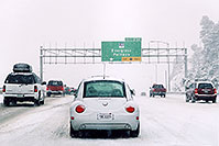 /images/133/2006-03-i70-cars-vw-bug.jpg - #02853: white VW Beetle Bug from California in a land of SUVs, during blizzard on Highway I-70 west of Golden … March 2006 -- I-70, Golden, Colorado