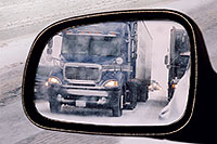/images/133/2006-03-i70-cars4.jpg - #02851: blue Semi truck in my side mirror, during blizzard on Highway I-70 west of Golden … March 2006 -- I-70, Golden, Colorado