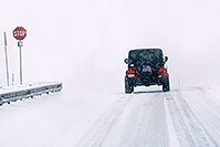 /images/133/2006-03-i70-red-jeep1.jpg - #02857: Red Jeep Wrangler entering the blizzard … March 2006 -- I-70, Golden, Colorado