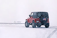 /images/133/2006-03-i70-red-jeep2.jpg - #02858: Red Jeep Wrangler turning off Highway I-70 … March 2006 -- I-70, Golden, Colorado