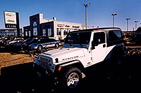/images/133/2006-03-lithia-jeep-sign1.jpg - #02875: white 2006 Jeep Wrangler Rubicon Unlimited at Lithia Jeep in Centennial … March 2006 -- Lithia Jeep, Centennial, Colorado