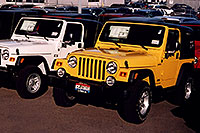 /images/133/2006-03-lithia-wranglers2.jpg - #02882: white 2006 Jeep Wrangler X and yellow Wrangler Sport at Lithia Jeep … March 2006 -- Lithia Jeep, Centennial, Colorado